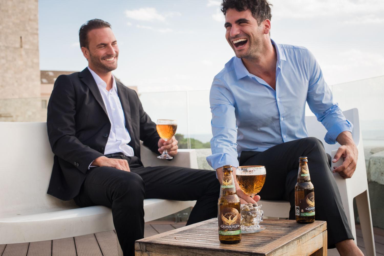 Two males enjoying Grimbergen Belgian Ale